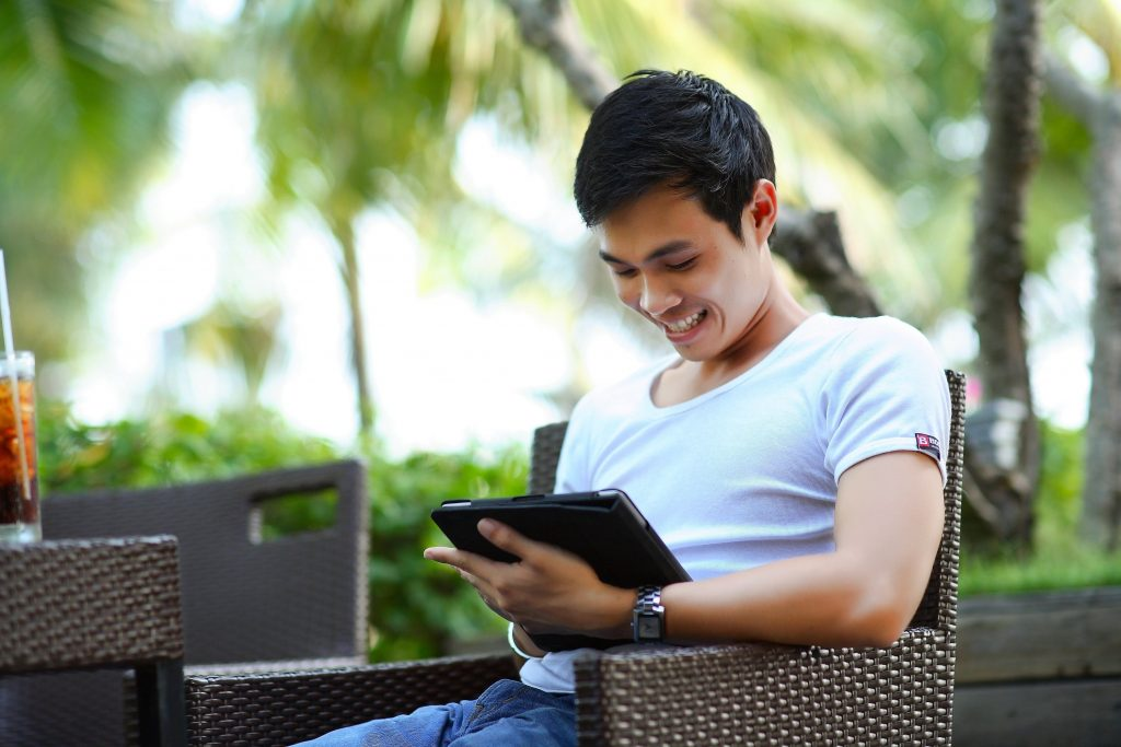 Man Working On Tablet