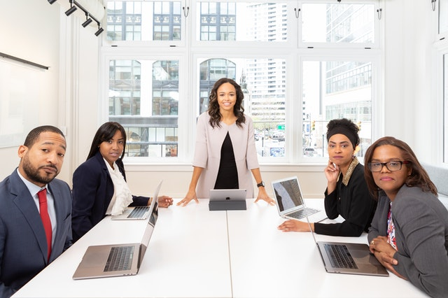 woman-standing-on-the-center-table-with-four-people