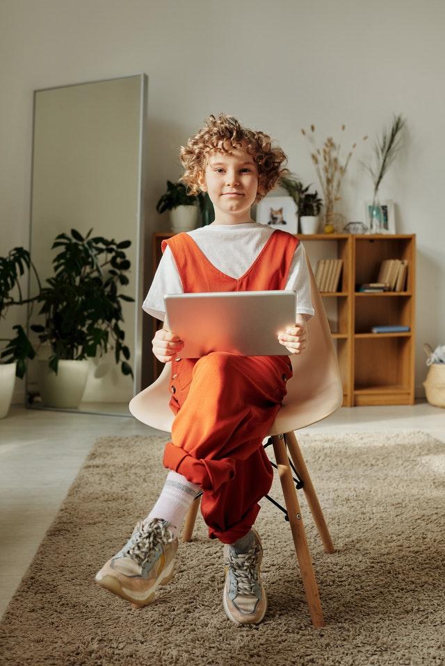 Child Sitting On Chair