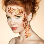 Autumn woman portrait with elegant hairstyle.  Perfect makeup